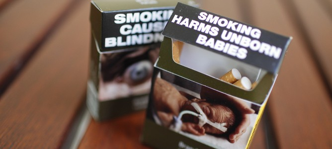 Cigarette packs with plain packaging is displayed at Parliament House in Canberra, Wednesday, Aug. 15, 2012. The High Court of Australia today rejected the legal challenge by tobacco companies against Australia's plain packeging of tobacco laws. (AAP Image/Lukas Coch) NO ARCHIVING