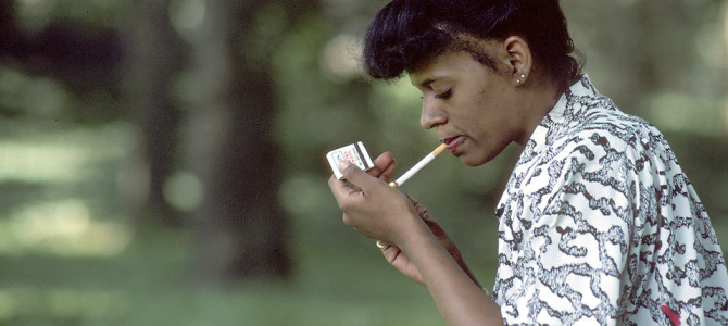 17323-an-african-american-woman-lighting-a-cigarette-pv