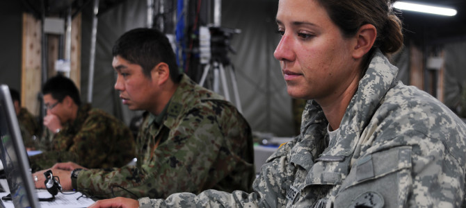 U.S. Army Capt. Brittany Woods, right, an operations officer with the U.S. Army Pacific contingency command post, works with Japan Ground Self Defense Force Capt. Kousei Matunaga, center, an exercise operations officer, in preparation for the Yama Sakura 61 exercise at Camp Itami, Osaka, Japan, Jan 23, 2012. Yama Sakura (YS) is an annual, bilateral exercise between the U.S. military and the Japan Self Defense Force and. YS is the largest command post exercise that focuses predominately on the bilateral and joint planning, coordination, and interoperability of ground based elements of the U.S./Japan security alliance. (U.S. Army photo by Pfc. Brandy Mort/Released)